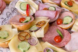 Bread rolls with cheese, salami and ham with tomatoes and cucumbers