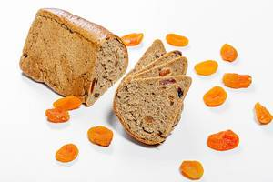 Bread with dried apricots on a white background