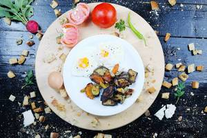Breakfast with fried eggs and grilled vegetables
