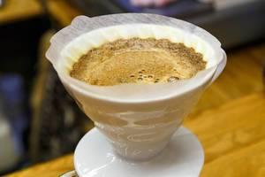 Brewing coffee into dripper Hario V60