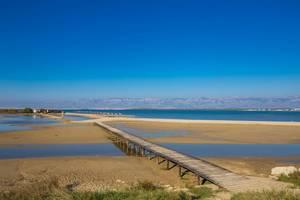 Bridge to sandy beach