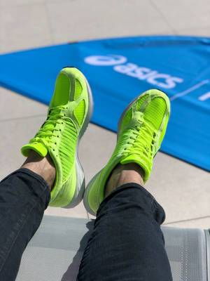 Brightly colored green ASICS running shoes