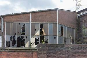 Broken windows of an old factory building
