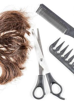 Brown-hair-with-scissors-and-combs-top-view.jpg