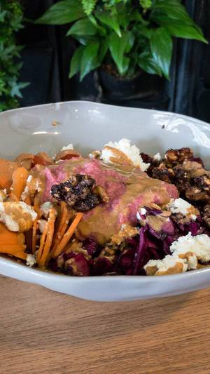 Brown rice, beetroot, carrots and sesame, pickled red cabbage, cherry tomato, roasted walnuts, ewe