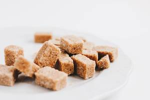 Brown sugar cubes , close up