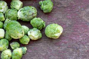 Brussels sprouts on old wooden background
