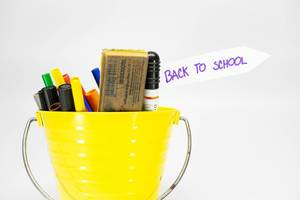 """Bucket with color pens and tag reading """"Back to School"""""""