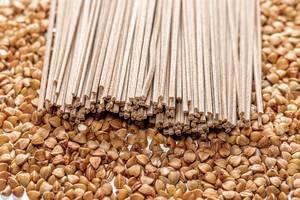 Buckwheat noodles soba on the background of raw buckwheat (Flip 2019)