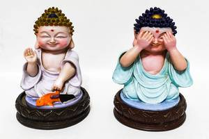 Buddha figurines isolated on white surface (Flip 2019)