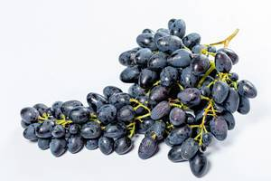 Bunch of fresh blue grapes on white background (Flip 2019)