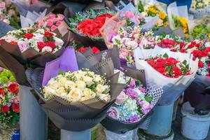 Bunch of Red, White and Rouge Roses in Buckets at a Street Flower Market in Ho Chi Minh City, Vietnam