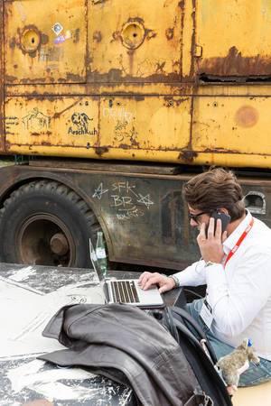 Business Man working on Macbook