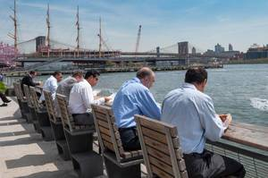Business Men having Lunch at Pier 15, East River Esplanade New York