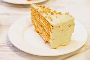 Butter-creamed cake slice on marble white table (Flip 2019)