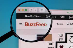 BuzzFeed logo under magnifying glass