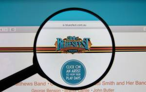 Byron Bay Bluesfest logo on a computer screen with a magnifying glass