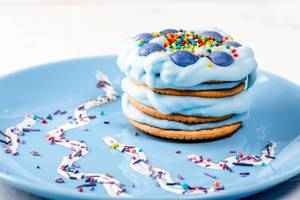 Cake with blue cream on a plate
