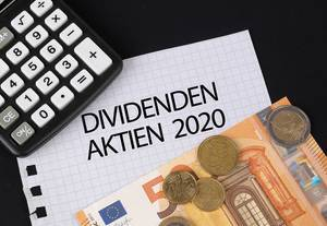 Calculator, money and Dividenden Aktien 2020 text on black table
