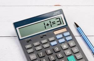 Calculator showing 1+1=3