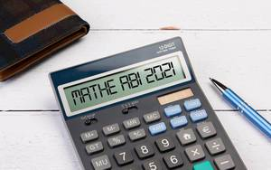 Calculator with the text Mathe Abi 2021 on the display