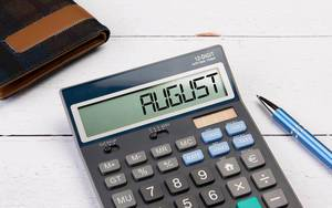 Calculator with the word August on the display