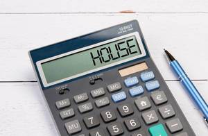Calculator with the word House on the display