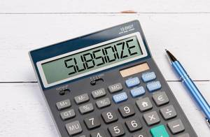 Calculator with the word Subsidize on the display