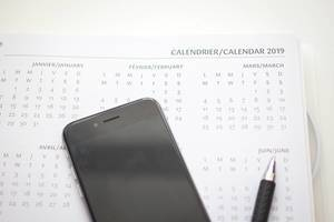 Calendar of 1029 with a smartphone and a pen on a table