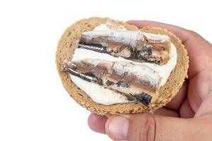 Canned Sardines Fish sandwich in the hand (Flip 2019)