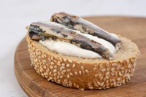 Canned Sardines Fish sandwich on the wooden board