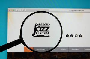 Cape Town International Jazz Festival logo on a computer screen with a magnifying glass