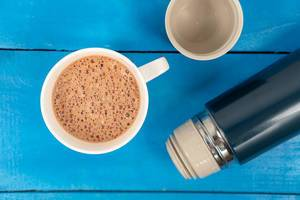 Cappuccino-with-Thermo-Bottle-on-the-wooden-board.jpg