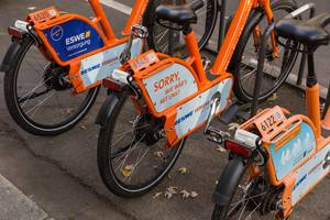 "Car-free city: orange bicycles by ESWE - ""MeinRad""- public bicycle rent system in Wiesbaden, Germany"