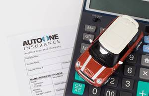 Car insurance policy with calculator and toy car