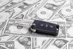 Car keys on hundred dollar banknotes