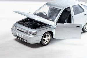 Car toy metal model VAZ 2112 with open doors and hood (Flip 2019)
