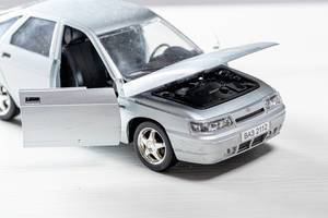 Car toy metal model VAZ 2112 with open doors and hood
