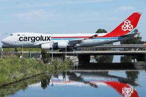 Cargolux jumbo taxiing on the bridge at Amsterdam Airport AMS