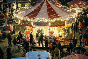 Carousel in Christmas market, night view