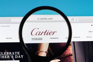 Cartier logo under magnifying glass
