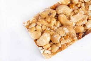 Cashew Bar slice on the white background