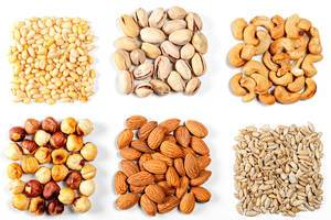 Cashew nuts, pistachios, pine nuts, almonds, hazelnuts and sunflower seeds on a white background (Flip 2020)