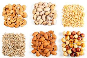 Cashew-nuts-pistachios-pine-nuts-almonds-hazelnuts-and-sunflower-seeds-on-a-white-background.jpg