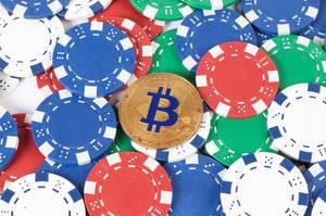 Casino chips and Bitcoin cryptocurrency