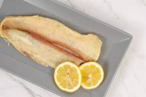 Catfish meat with Lemon served on the plate (Flip 2019) (Flip 2019)