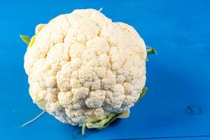 Cauliflower on the blye wooden board (Flip 2019)