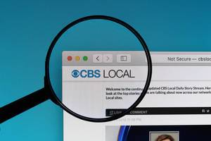 CBS Local logo under magnifying glass