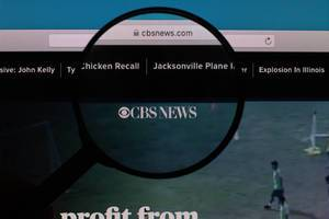 CBS News logo under magnifying glass