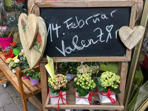 Celebrating valentines day with flowers and heart shaped wood